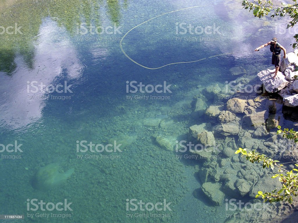 Fly Fishing Crystal Clear Rocky Mountain River stock photo