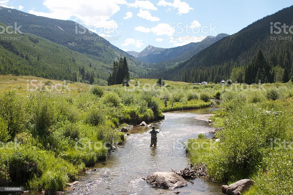 Fly Fishing in a Stream stock photo