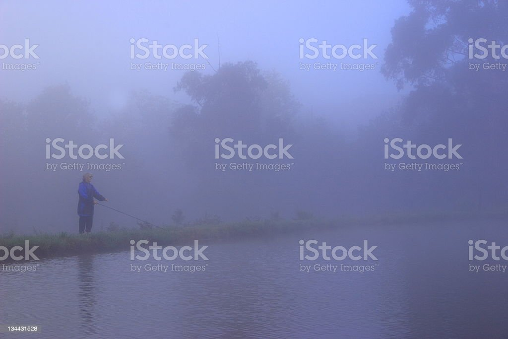 Fly fishing in the mist royalty-free stock photo