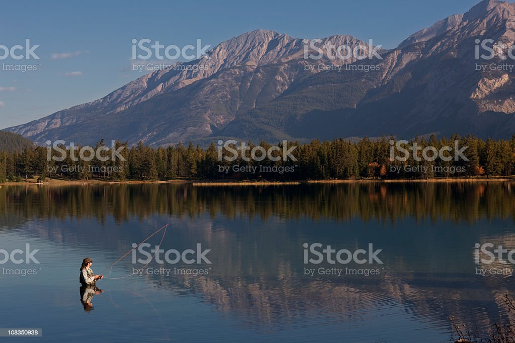 Fly Fishing On Lake Edith In Rocky Mountains, Alberta, Canada royalty-free stock photo