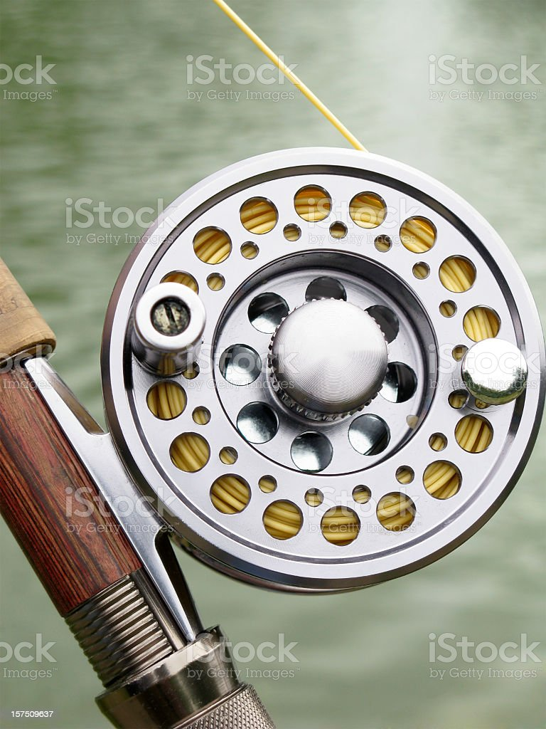 Fly fishing reel. royalty-free stock photo
