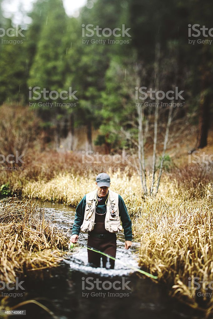 Fly Fishing Rod and Boots royalty-free stock photo