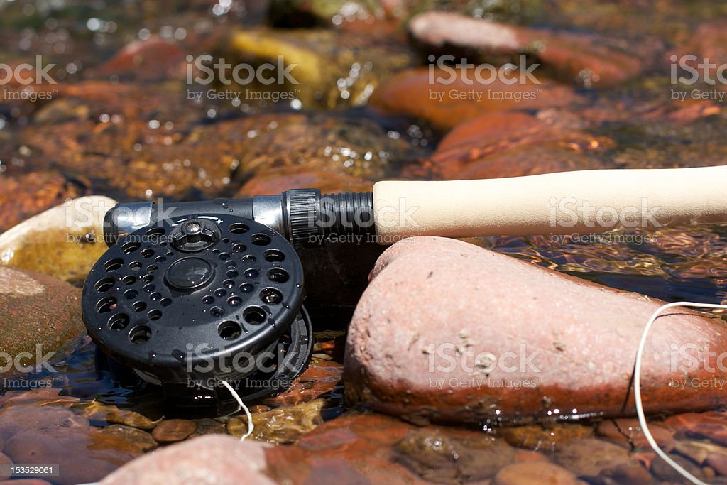 Fly Fishing Rod in Stream stock photo