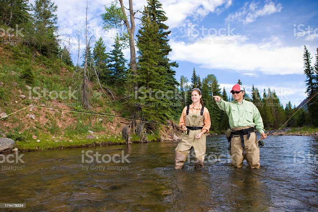 Fly Fishing Together in Mountain Stream stock photo