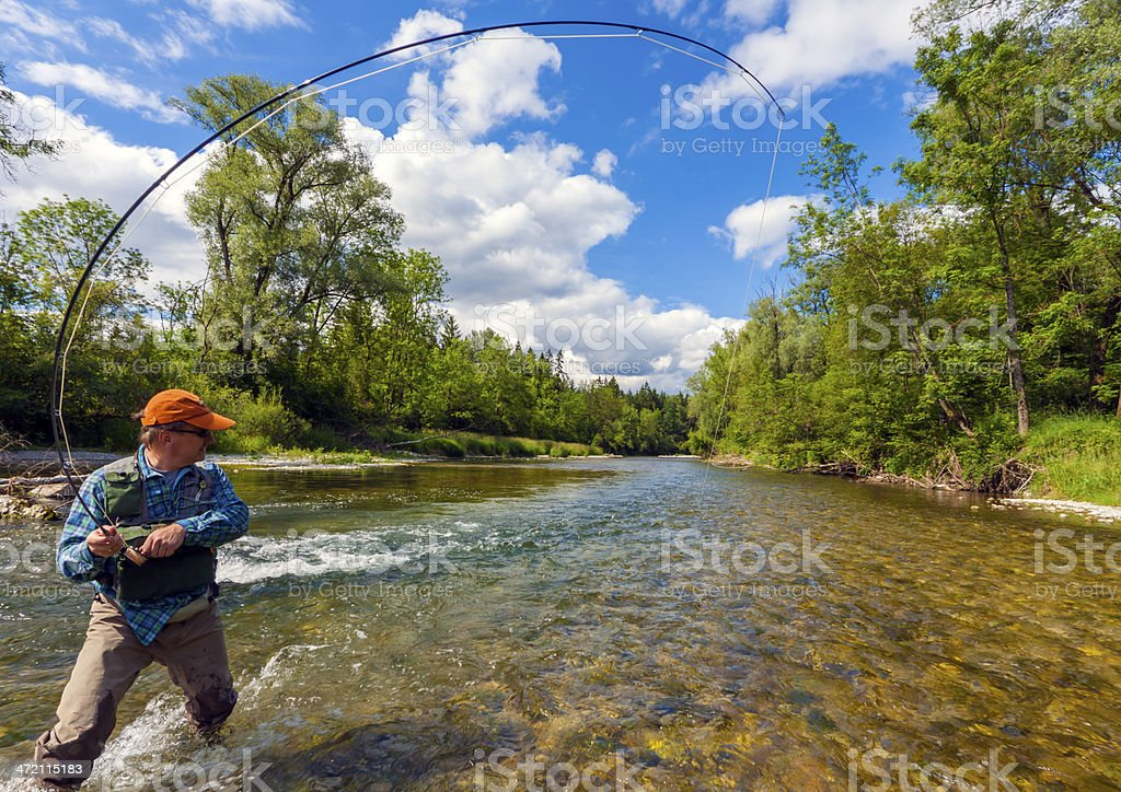 Fly fishing with success stock photo