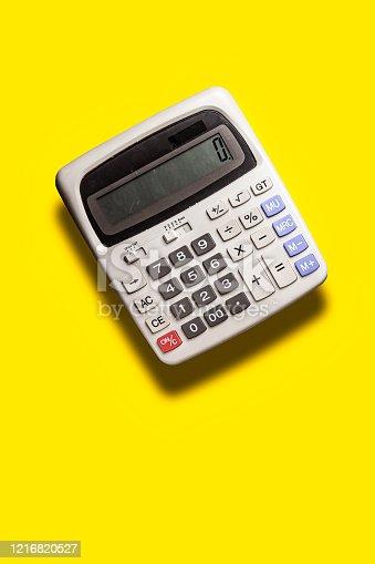 istock fly grey big calculator on yellow background 1216820527