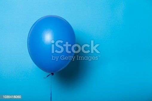 Fly helium balloon, isolated mockup concept. Blue background.