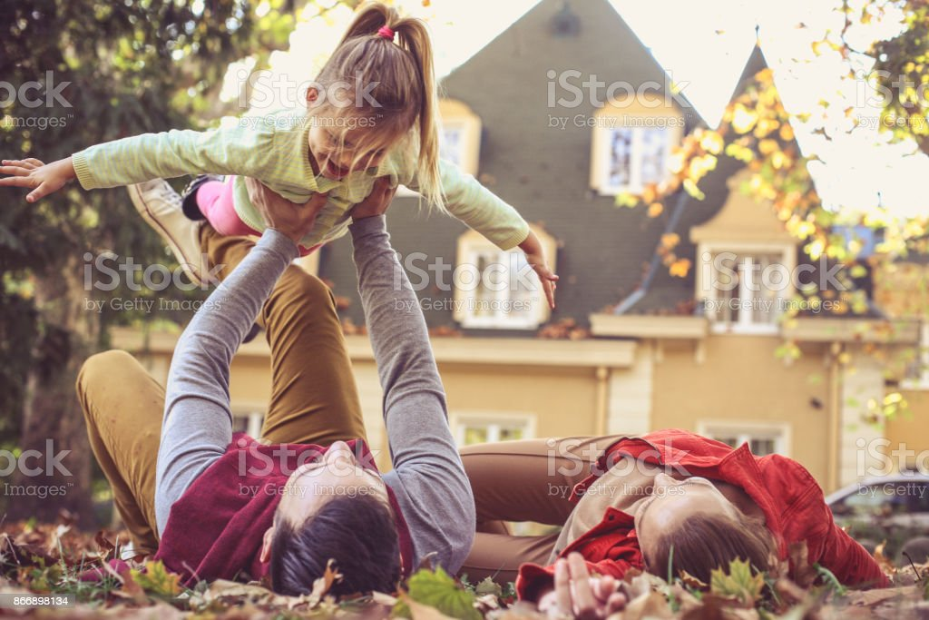 Fly little girl. Father playing with daughter. stock photo