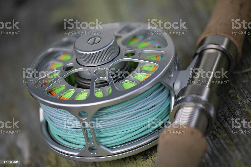 Fly reel on rod stock photo