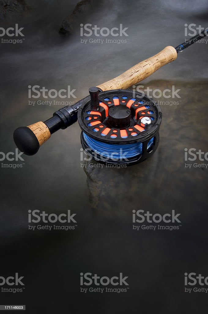 Fly rod in babbling brook stock photo