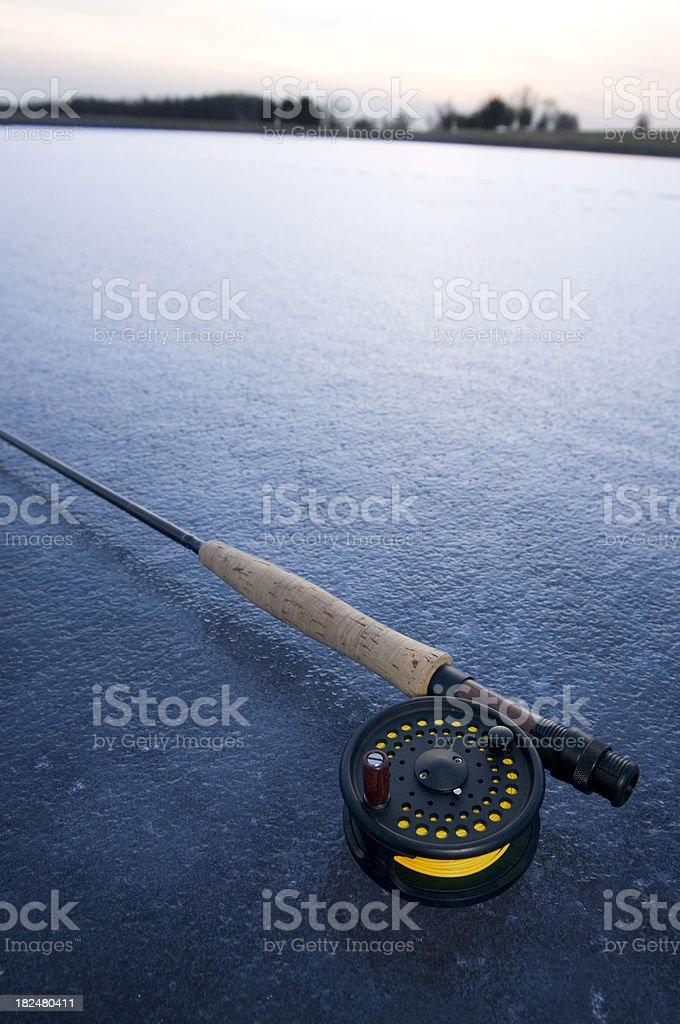 Fly rod on blue ice stock photo