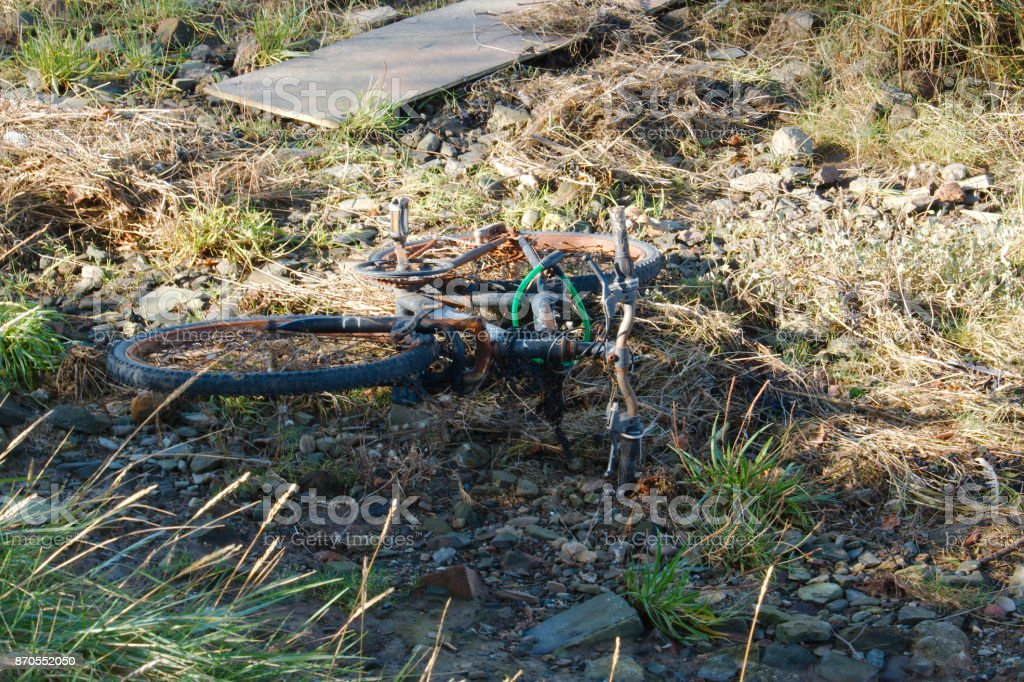 A fly tipped, and rusting, mountain bike. stock photo