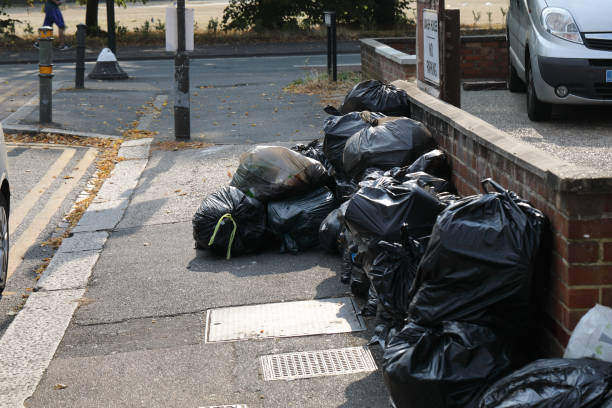 Fly tipping black plastic garbage bags on London street stock photo