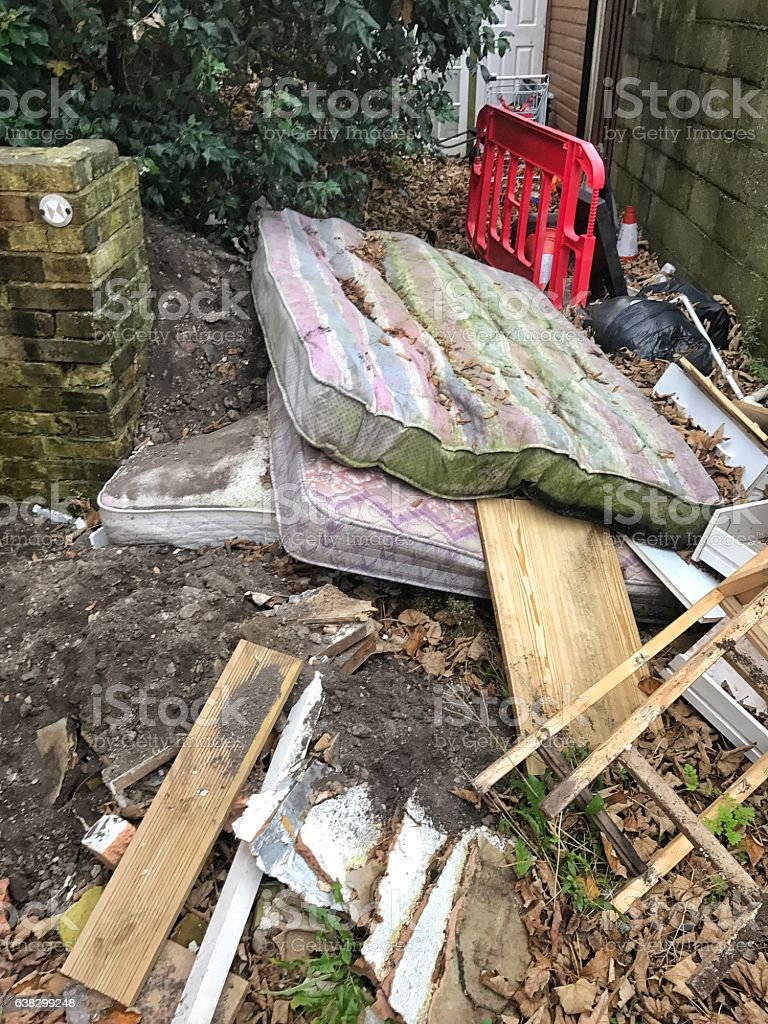 Fly Tipping in an urban environment UK stock photo