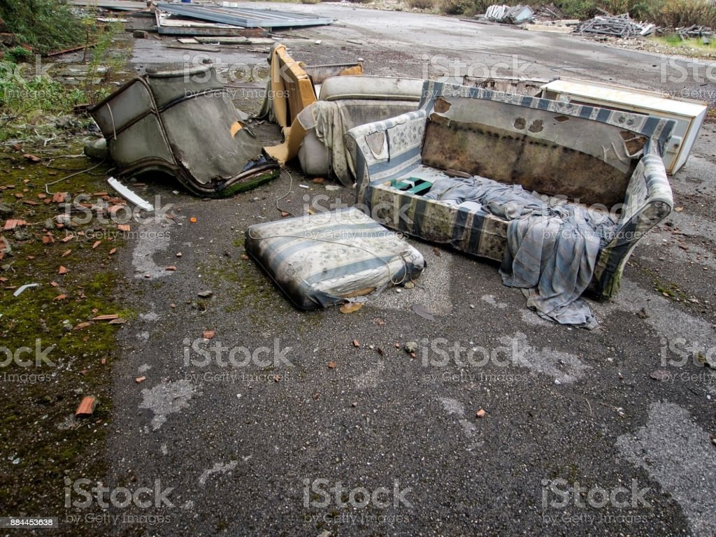 Fly tipping on waste ground. Domestic rubbish. stock photo