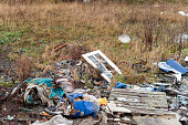 istock Fly Tipping on Wasteland with of Doors and Pallets 1196243581