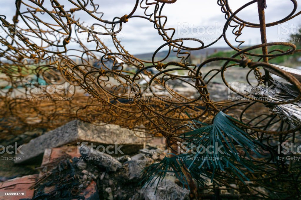 Fly Tipping Through A The Rusty Metal Spring Frame Of A Mattress Stock Photo Download Image Now Istock