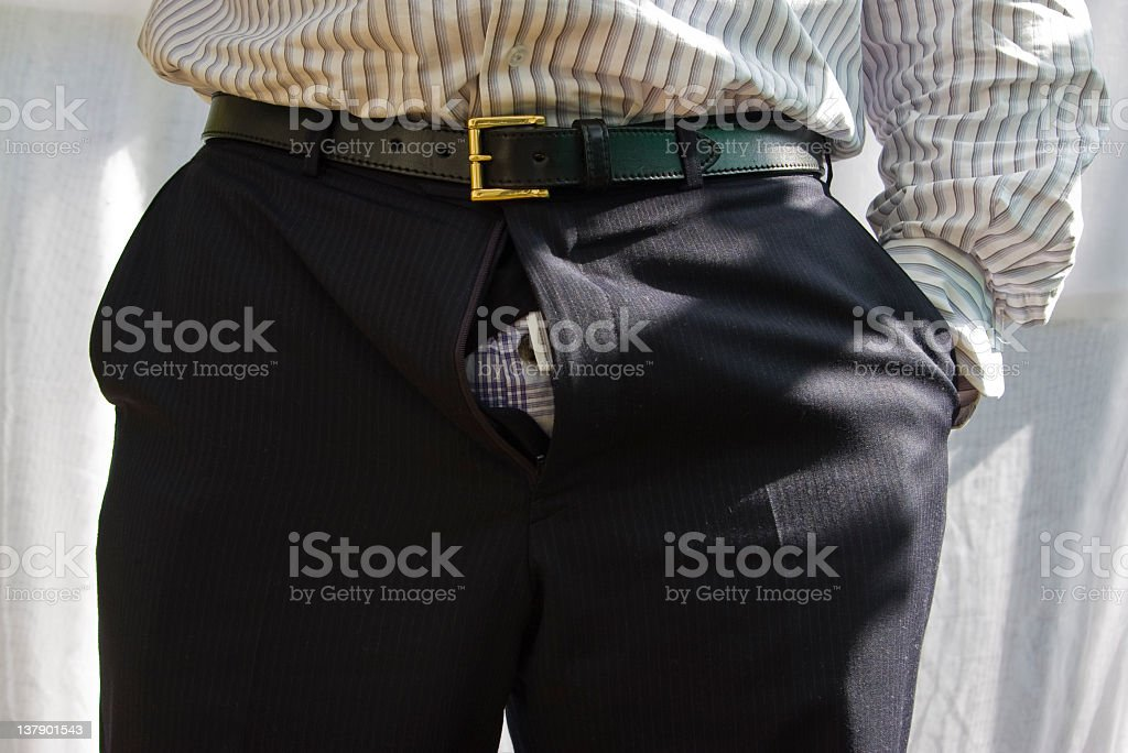 Fly undone in suit trousers stock photo