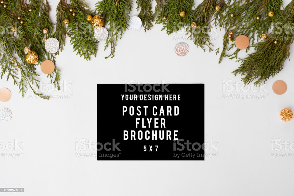 flyer Christmas composition. Christmas gift, knitted blanket, pine cones, fir branches on wooden white background. Flat lay, top view stock photo