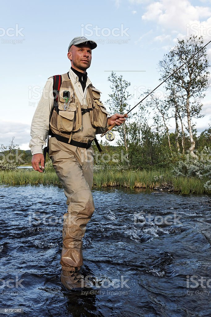 Fly-fisher Wading royalty-free stock photo