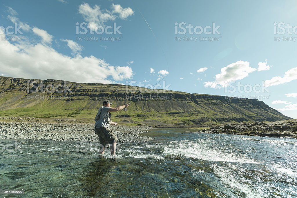 Flyfisherman casting the fly royalty-free stock photo