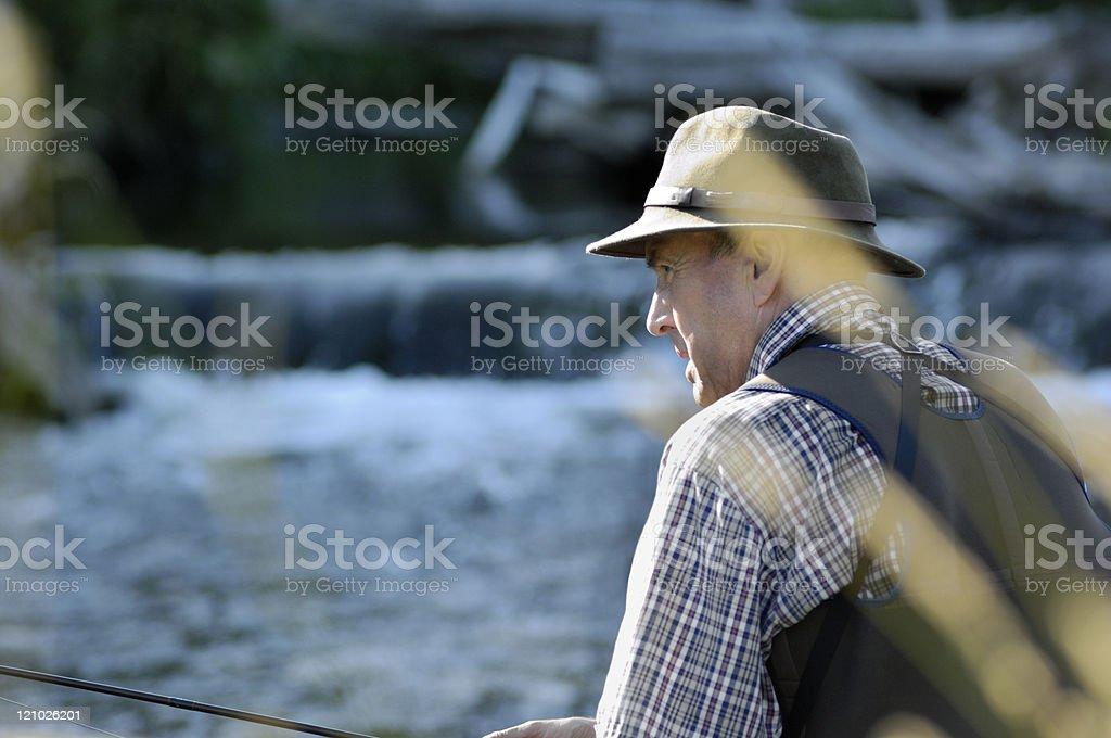 Fly-fisherman fishing stock photo