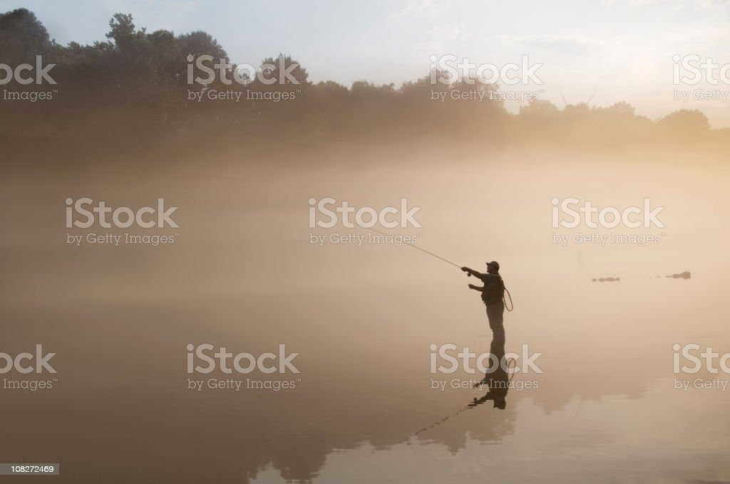 Flyfisherman in the Fog royalty-free stock photo