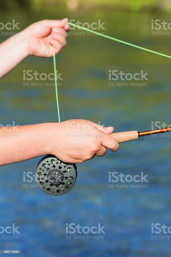 Fly-fishing: fooling the fish royalty-free stock photo