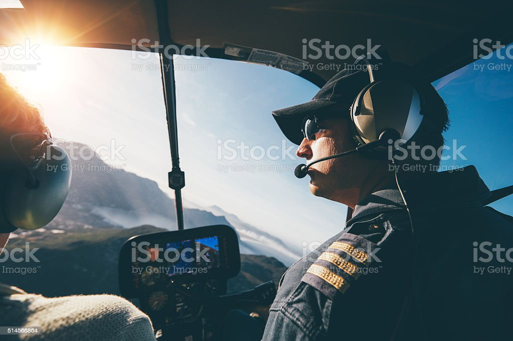 Flying a helicopter on a sunny day stock photo
