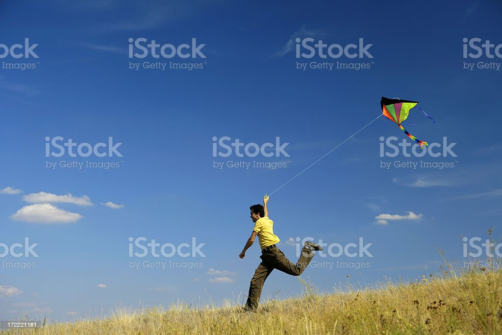 Flying a kite royalty-free stock photo