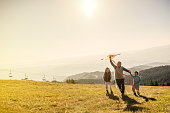 istock Flying a kite with Grandfather 614645392