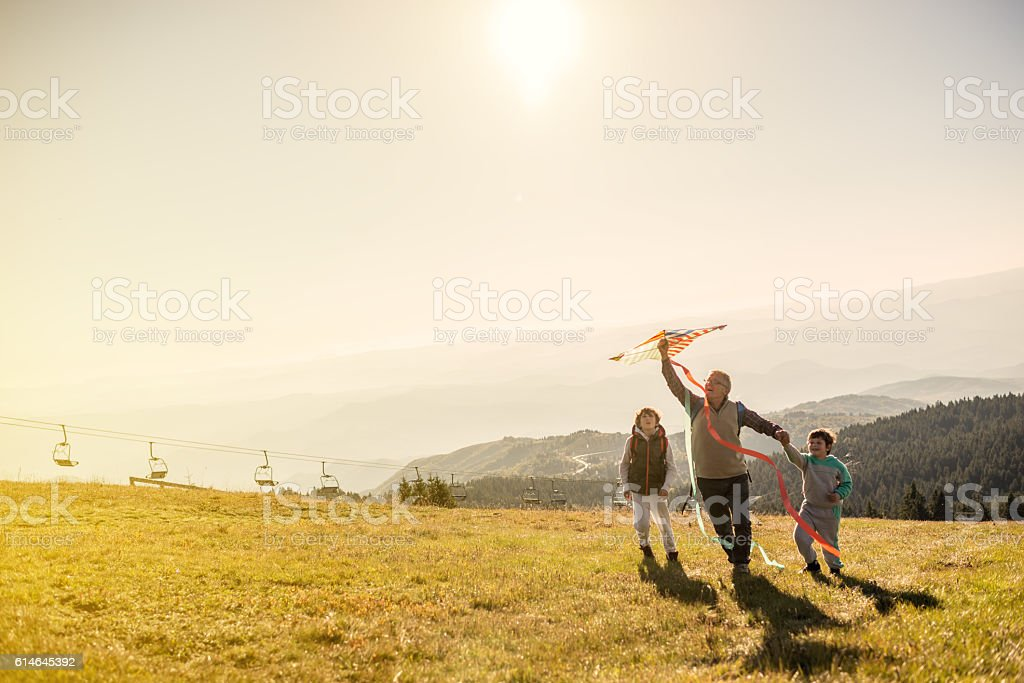 Flying a kite with Grandfather stock photo