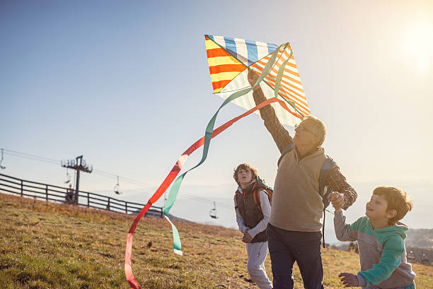 Flying a kite with Grandfather - foto stock