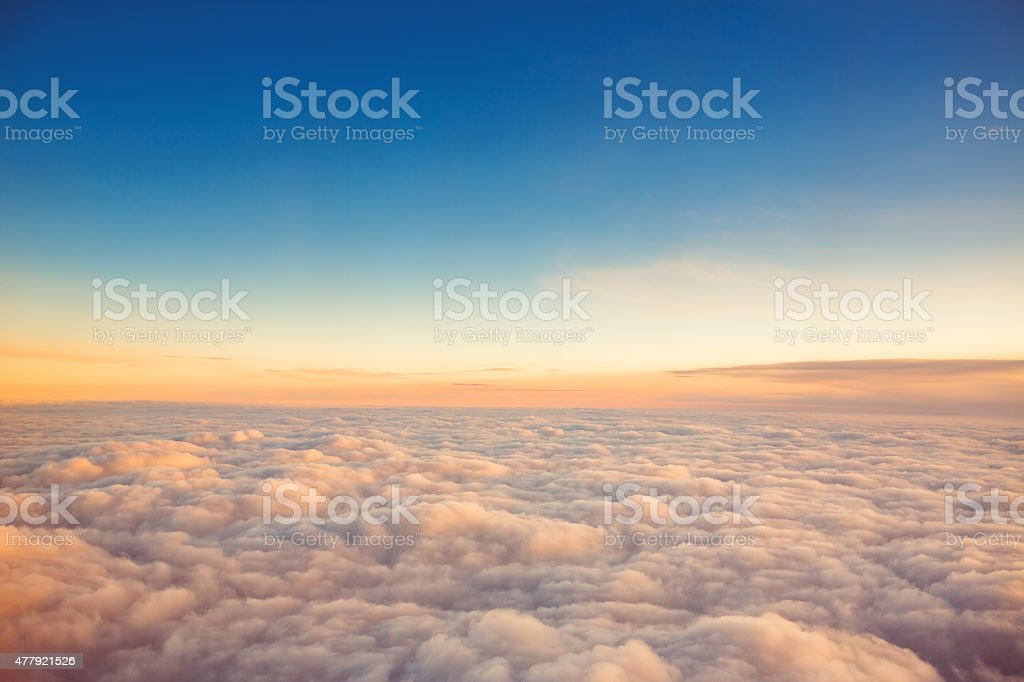 Flying above the clouds. view from the airplane stock photo