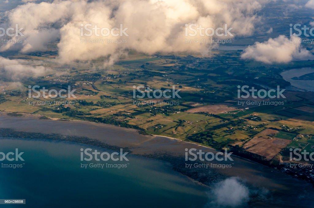 Flying above the clouds, view from the airplane - Zbiór zdjęć royalty-free (Atmosfera - Wydarzenia)