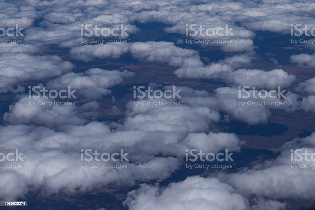 Flying above the clouds. View from the airplane, soft focus.