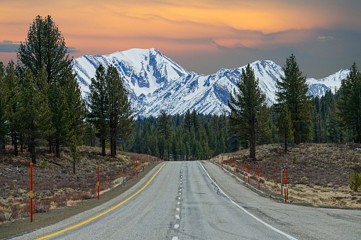 istock AERIAL Flying above the empty interstate road with a perfect view of the Rockies 1182818260