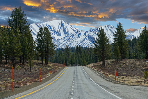 istock AERIAL Flying above the empty interstate road with a perfect view of the Rockies 1182821867