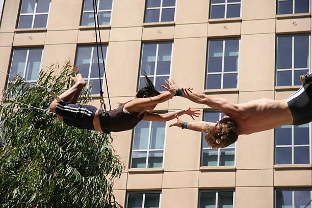 flying acrobats_1 - trapez stock-fotos und bilder