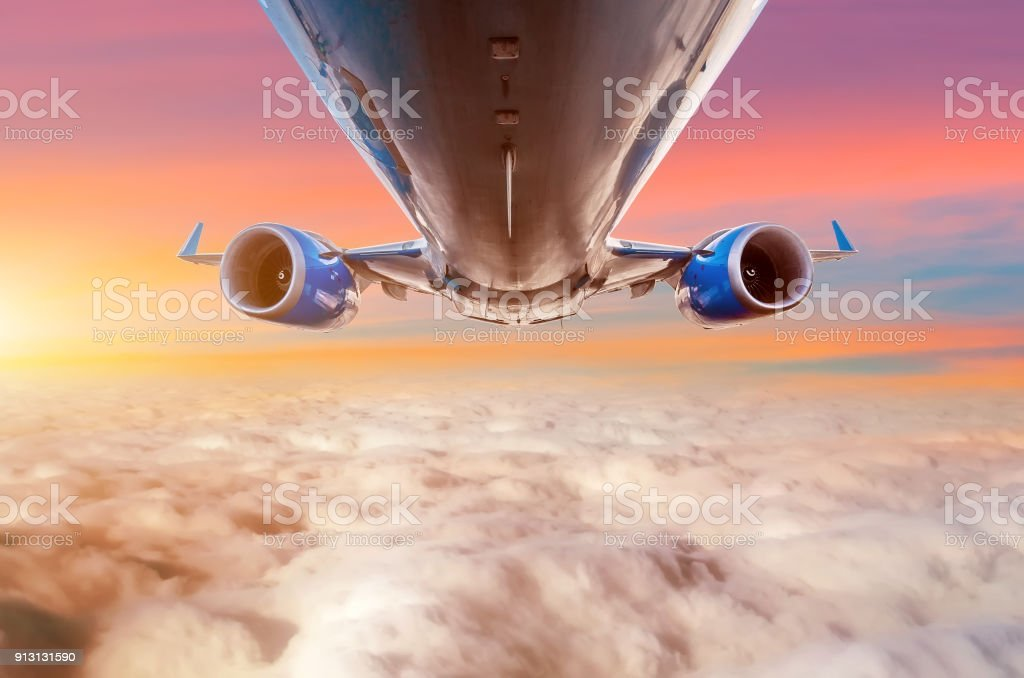Flying aircraft on the echelon view back to the fuselage and wings with engines. stock photo