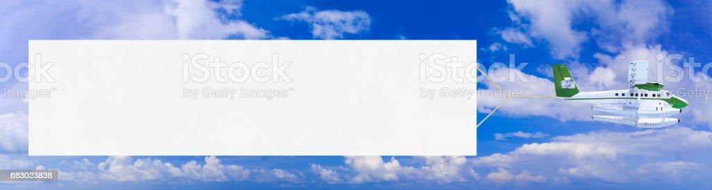 Vol avion et bannière - Photo