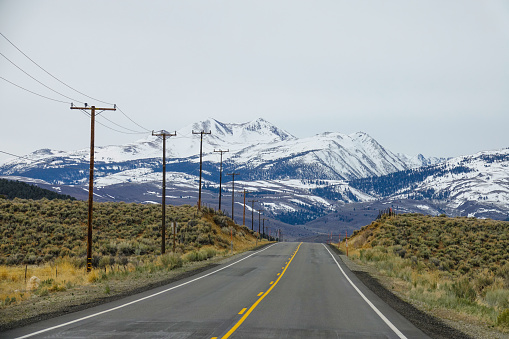 istock AERIAL: Flying along the scenic road leading to the spectacular Rocky mountains. 1182821926