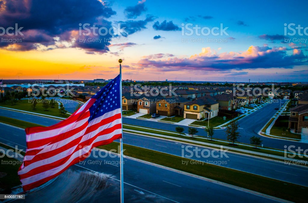 Flying American Pride United States Flag Flying during amazing colorful Sunset stock photo