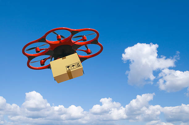 Flying arial drone with a packet and cloudy sky – Foto