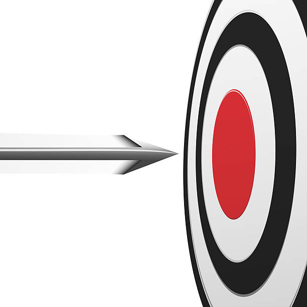 Flying arrow to the red center of round target stock photo