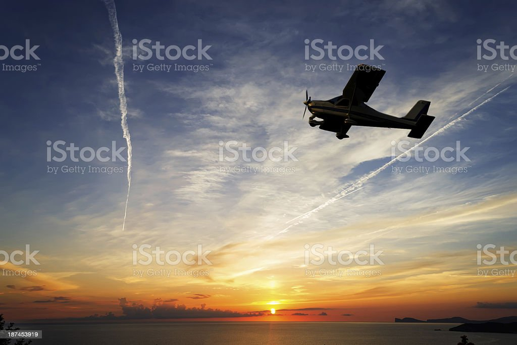 flying at sunset stock photo