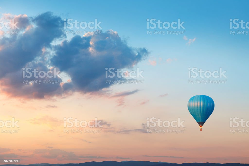 Flying balloon on evening sky stock photo