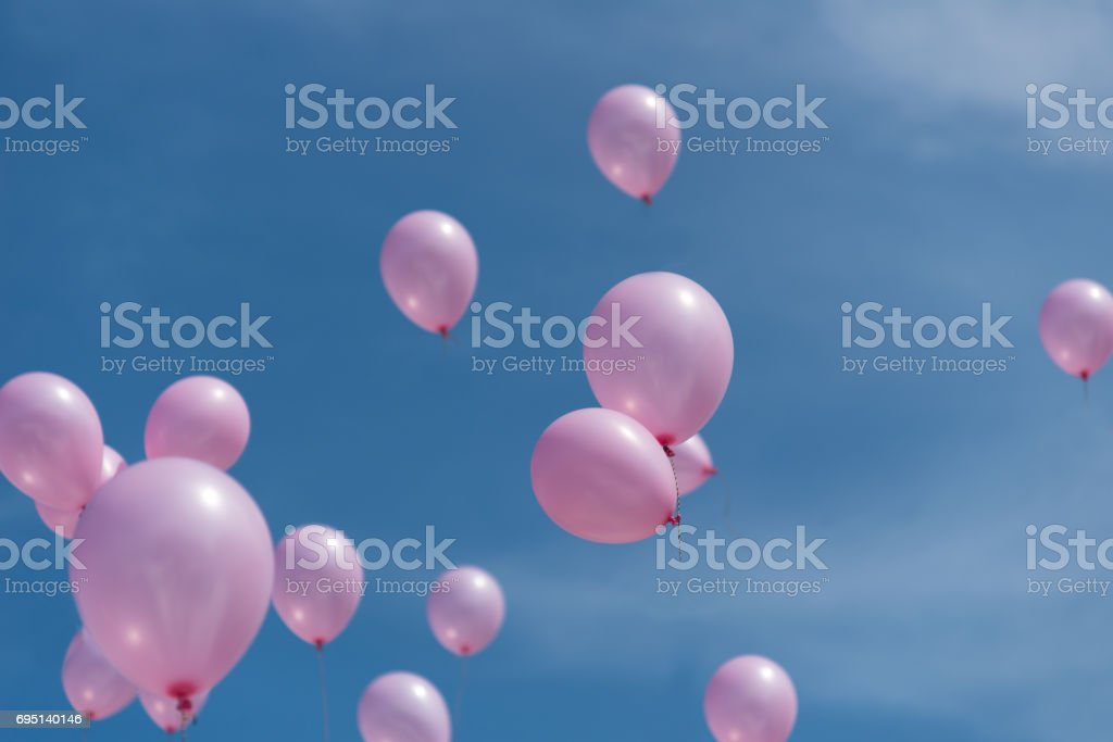 flying balloons in the blue sky stock photo