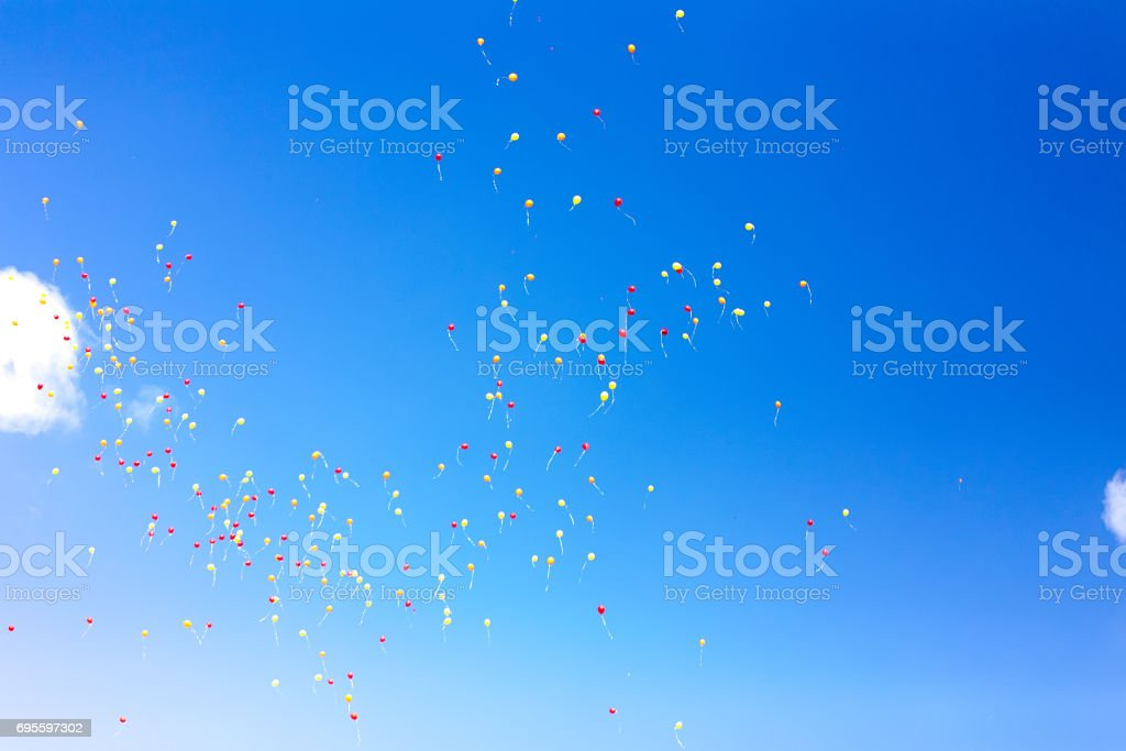 Flying balloons in the sky stock photo