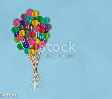 istock Flying balloons on textured background, paper cutting style 825722248